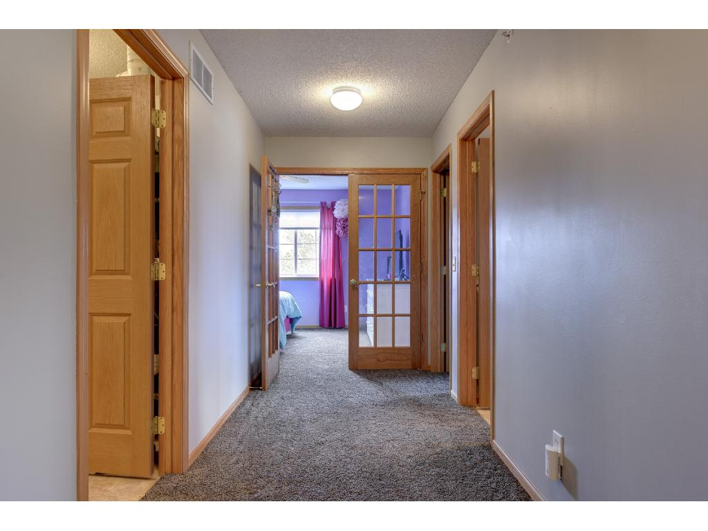 Upper level includes the master bedroom + 2 additional bedrooms (or 1 plus den), full bath and laundry room