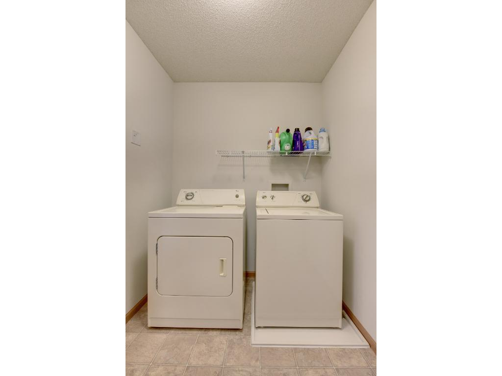 laundry is on the upper level with bedrooms and bathroom