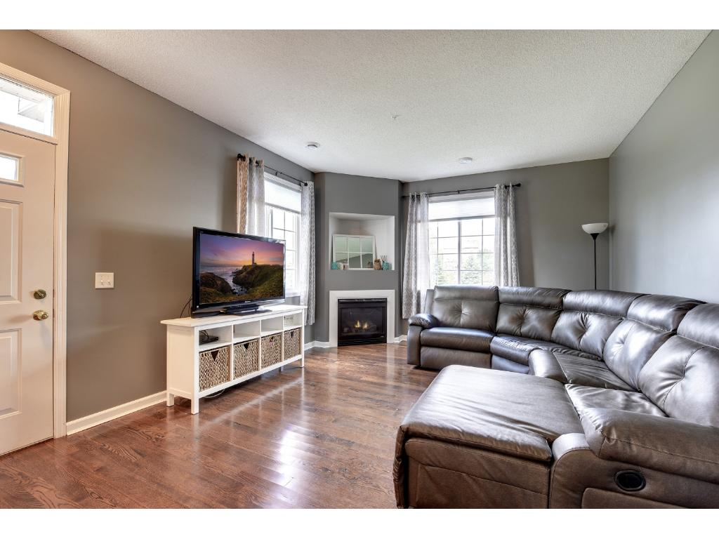 main floor living space includes a gas fireplace, and newly buffed hardwood floors