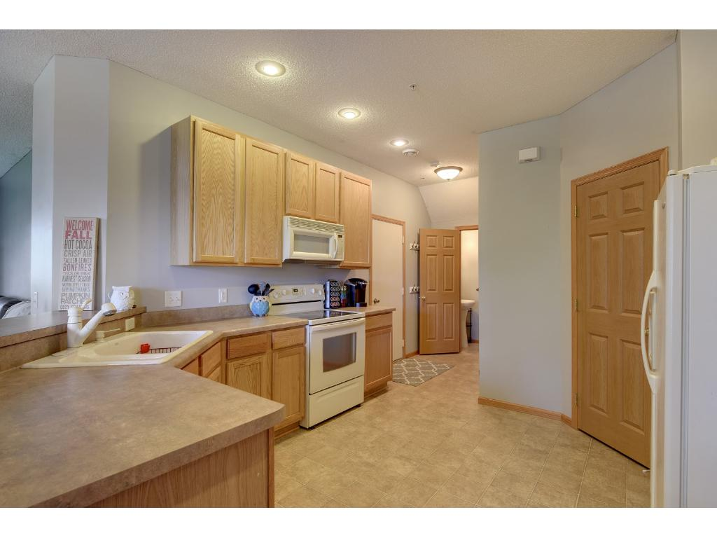 spacious kitchen has plenty of cabinets + a walk in pantry for storage