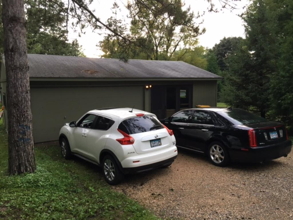 Large 2 car garage with an attached bonus room