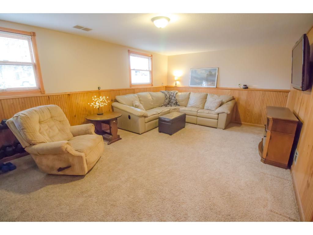 Spacious lower level family room offers full daylight windows and beadboard wainscoting with ledge.