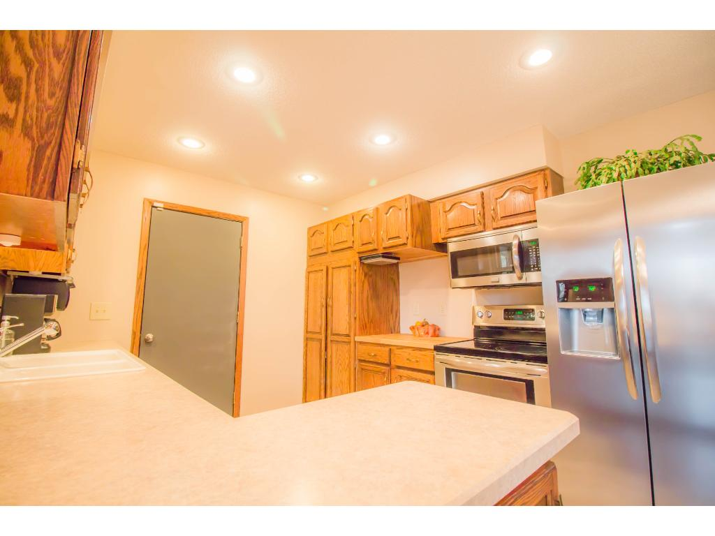 The kitchen is nicely updated with new counters, flooring and stainless steel appliances.