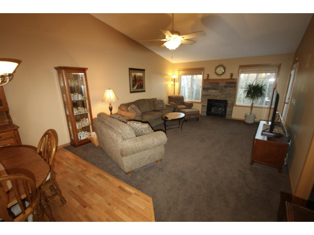 From vaulted ceilings, stone fireplace, wooded views and gorgeous deck off living room!