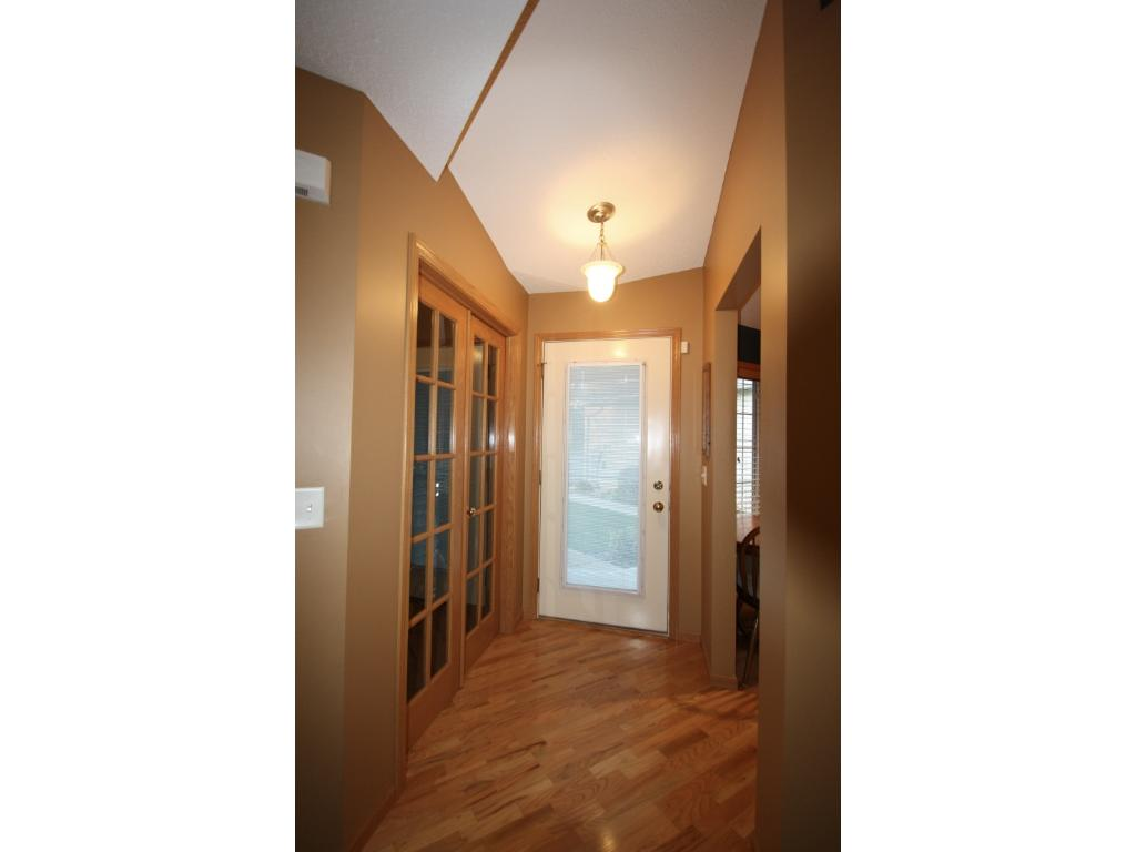 Hardwood floors and French doors at entry.
