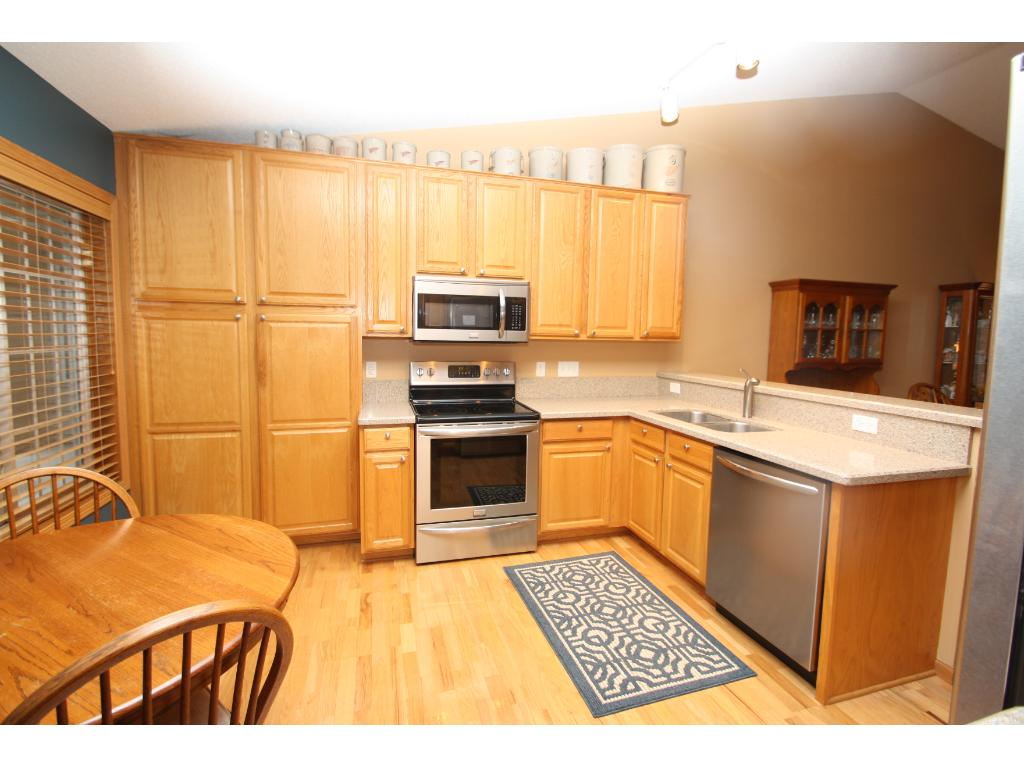 Hardwoods carry into kitchen with granite, new stainless appliances and extended-height cabinetry.