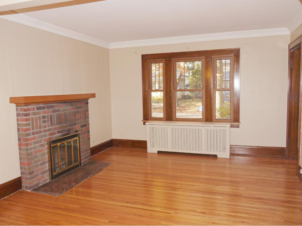 West facing front living room with full masonry fireplace.