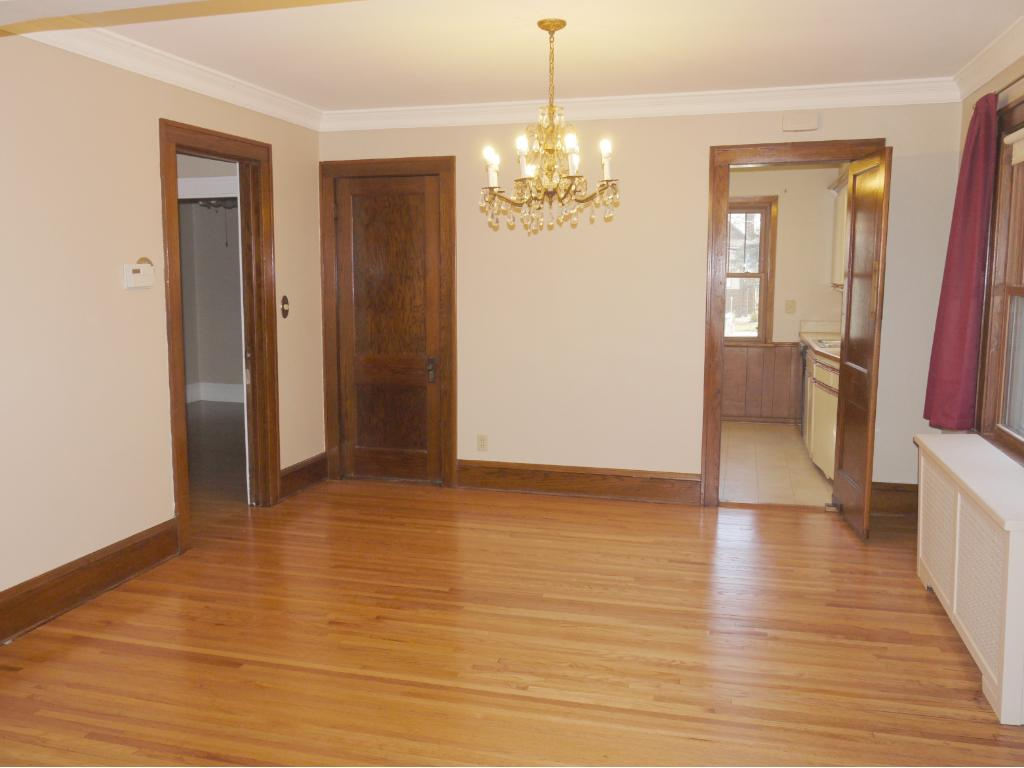 Formal dining room adjacent to kitchen and living room.