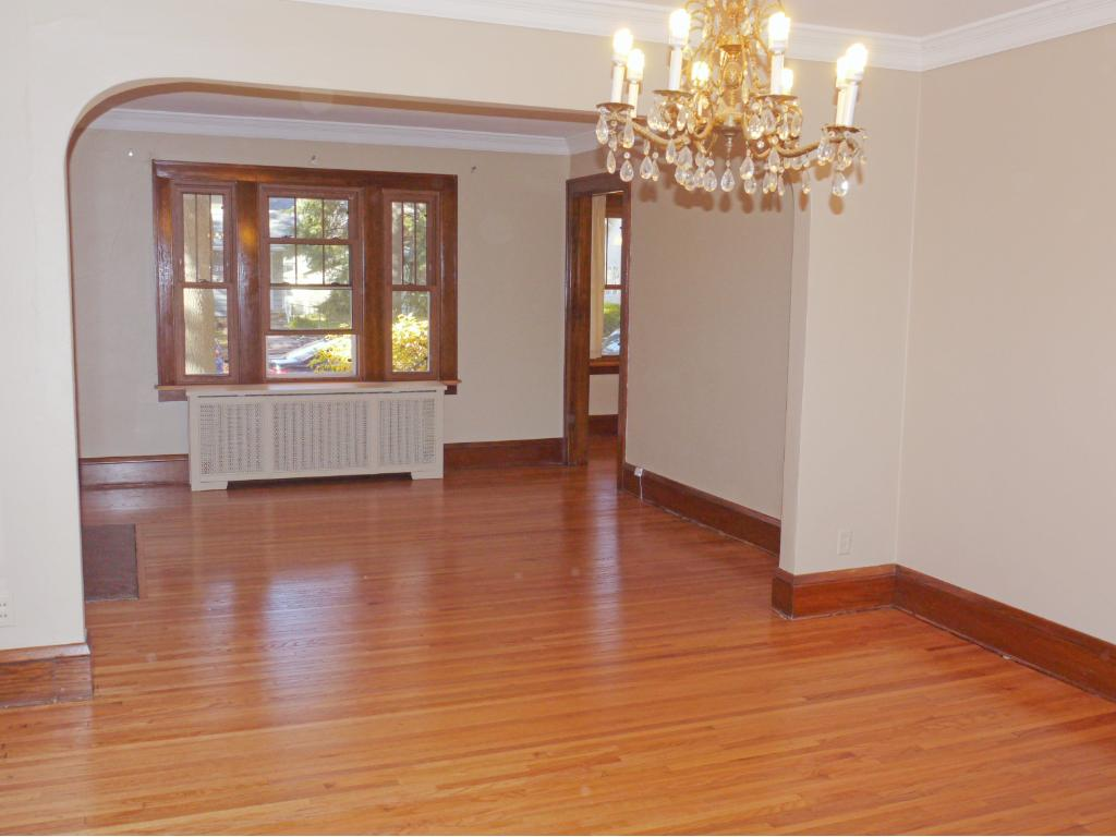 Long view of dining room and living room from kitchen.