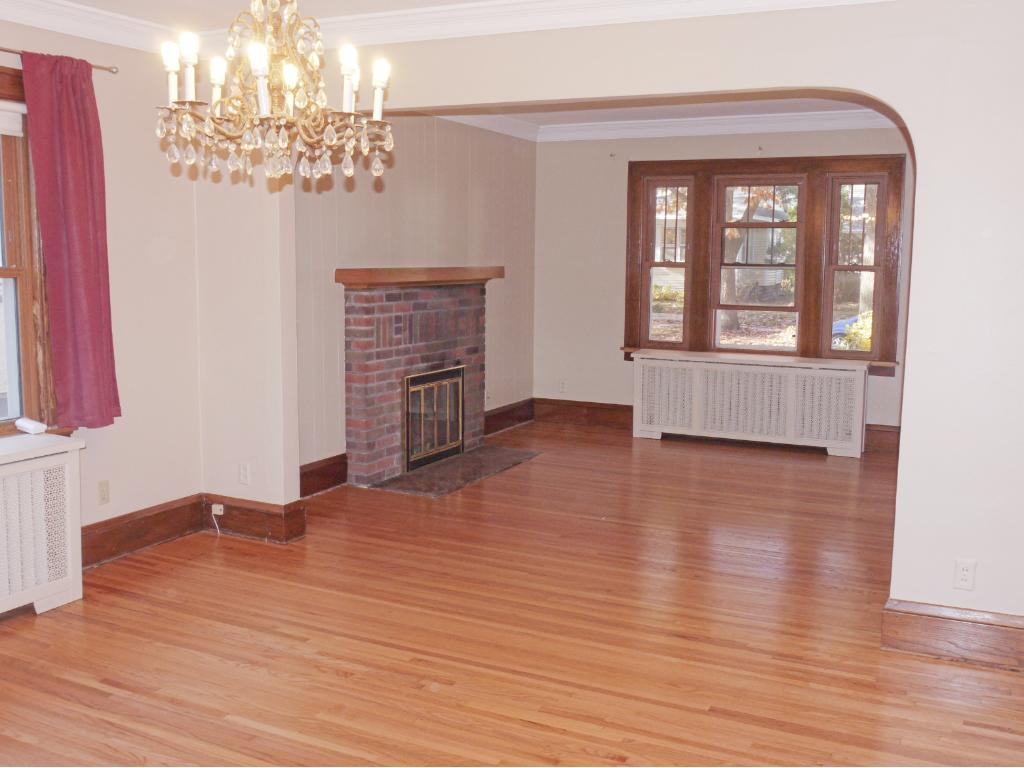Long view of dining room and living room from main hall.
