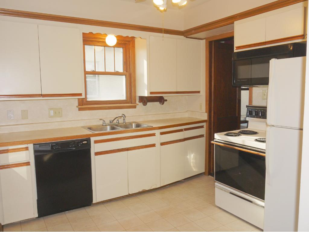 Updated kitchen with Euro cabinets and access to sun porch.