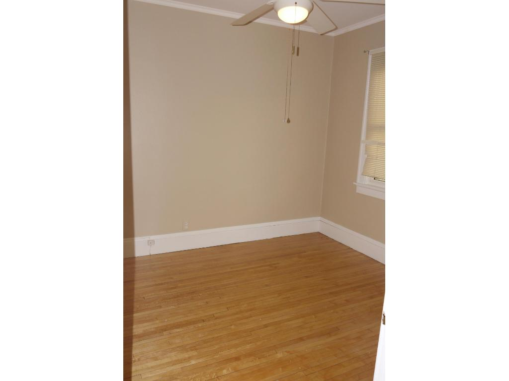 Second bedroom with newly finished hardwood floors.