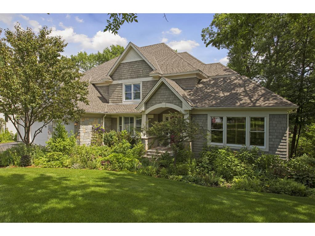 Welcome to 13940 Emerald Ridge! This Custom Built, Executive 2-Story Home is located on a Private, Wooded Lot within minutes of Downtown Minneapolis...