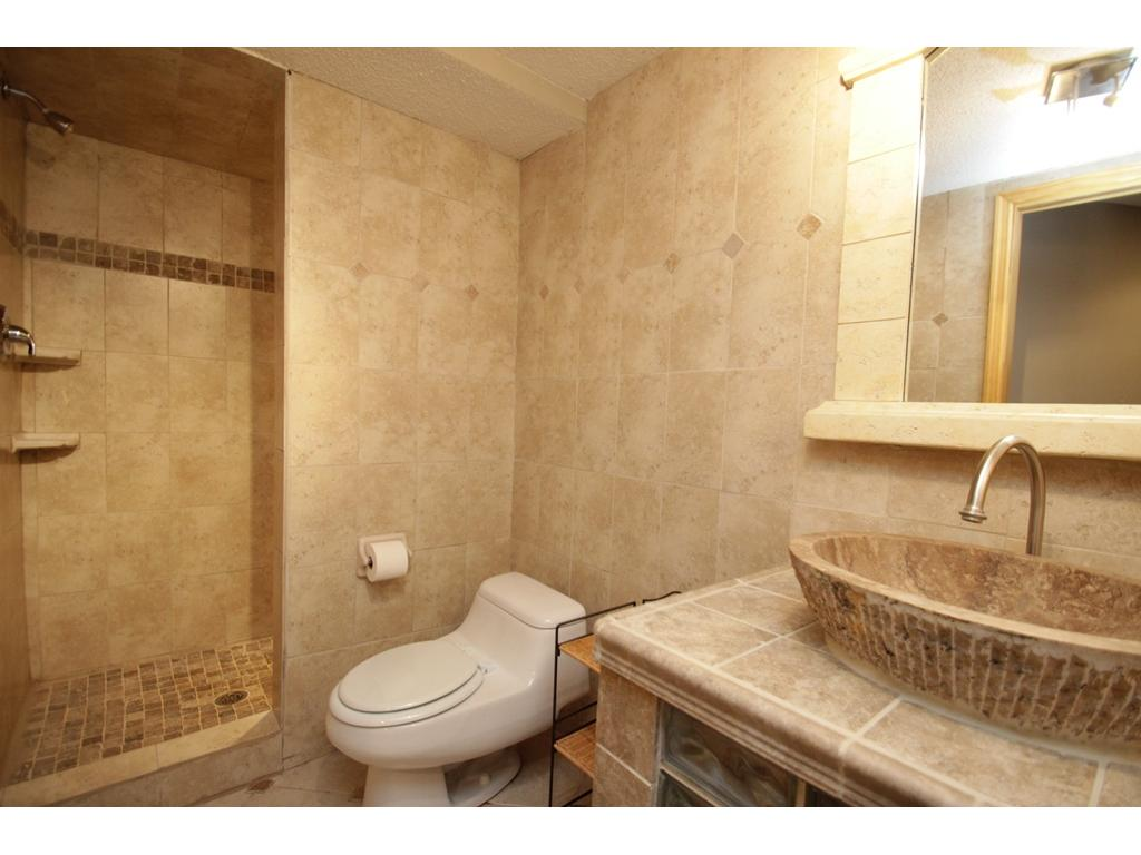 Lower level bathroom with tile surround and a full walk-in tiled shower!