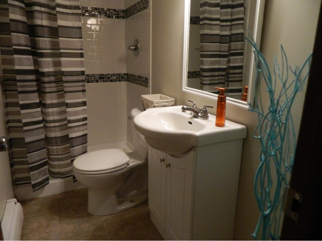 3/4 bath with all new tile shower surround in lover level.