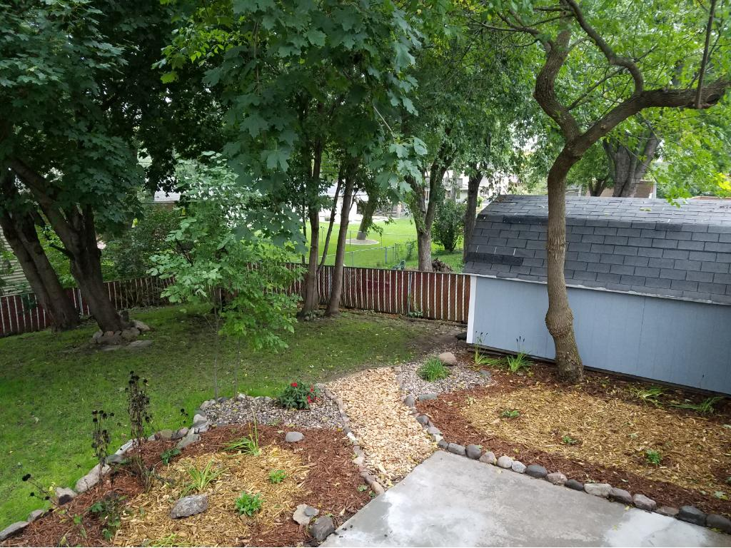 Private back yard with new landscaping, deck and patio with a fenced in back yard.