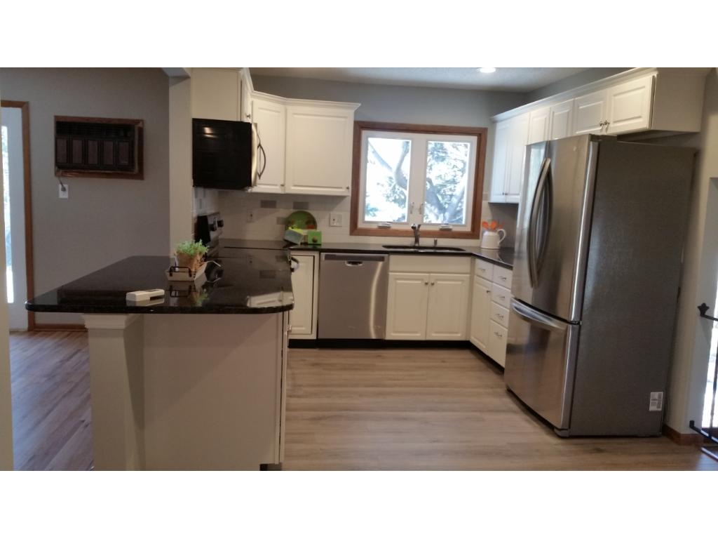New cabinets, granite counter, flooring.  Nice open eat-in kitchen.