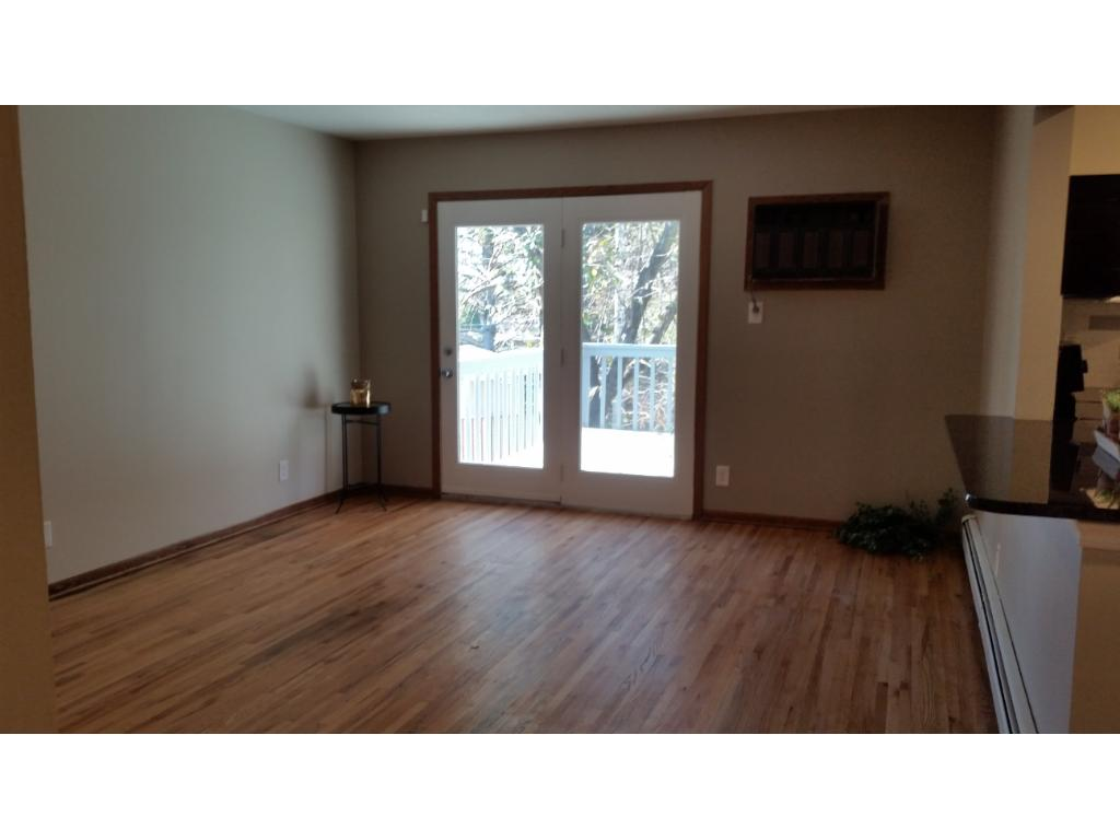 Living room or could be used as a formal dining room.  Patio door goes out to large deck over looking the back yard.