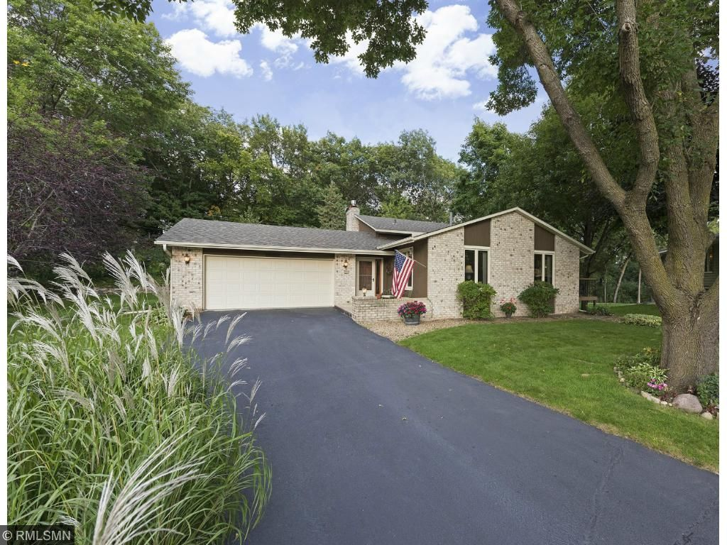 Welcome home to 14001 Vale Court.  Lots of great tree coverage and privacy to the rear of the home.