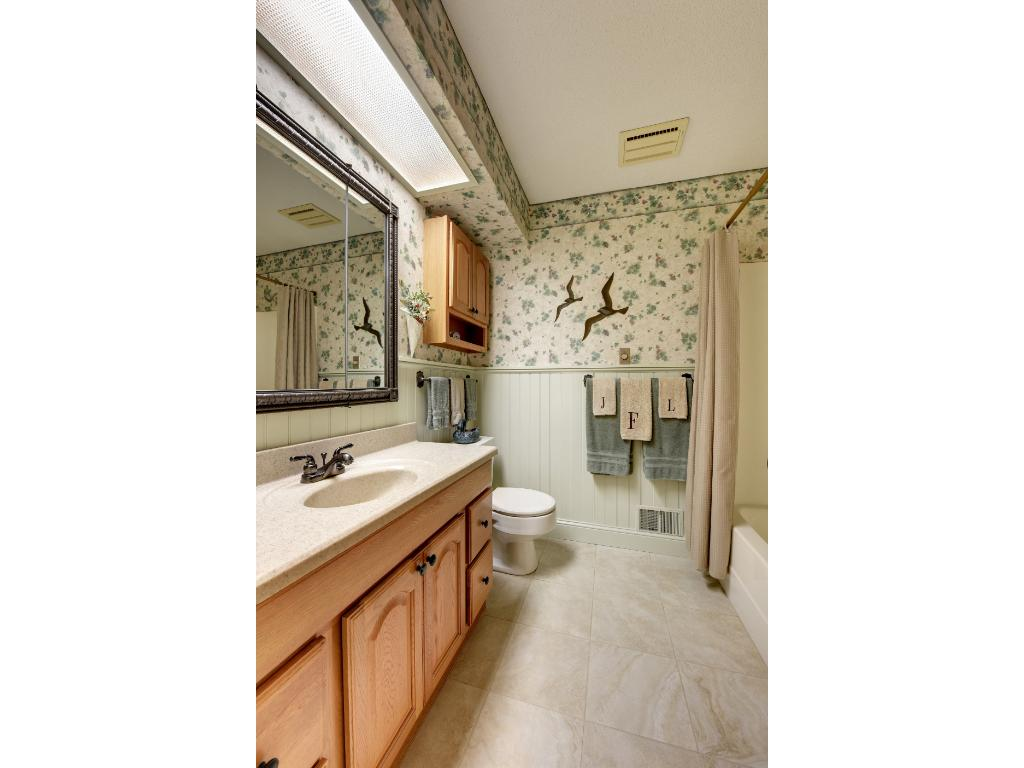 Upper Level Main Full Bathroom with great wainscoting.