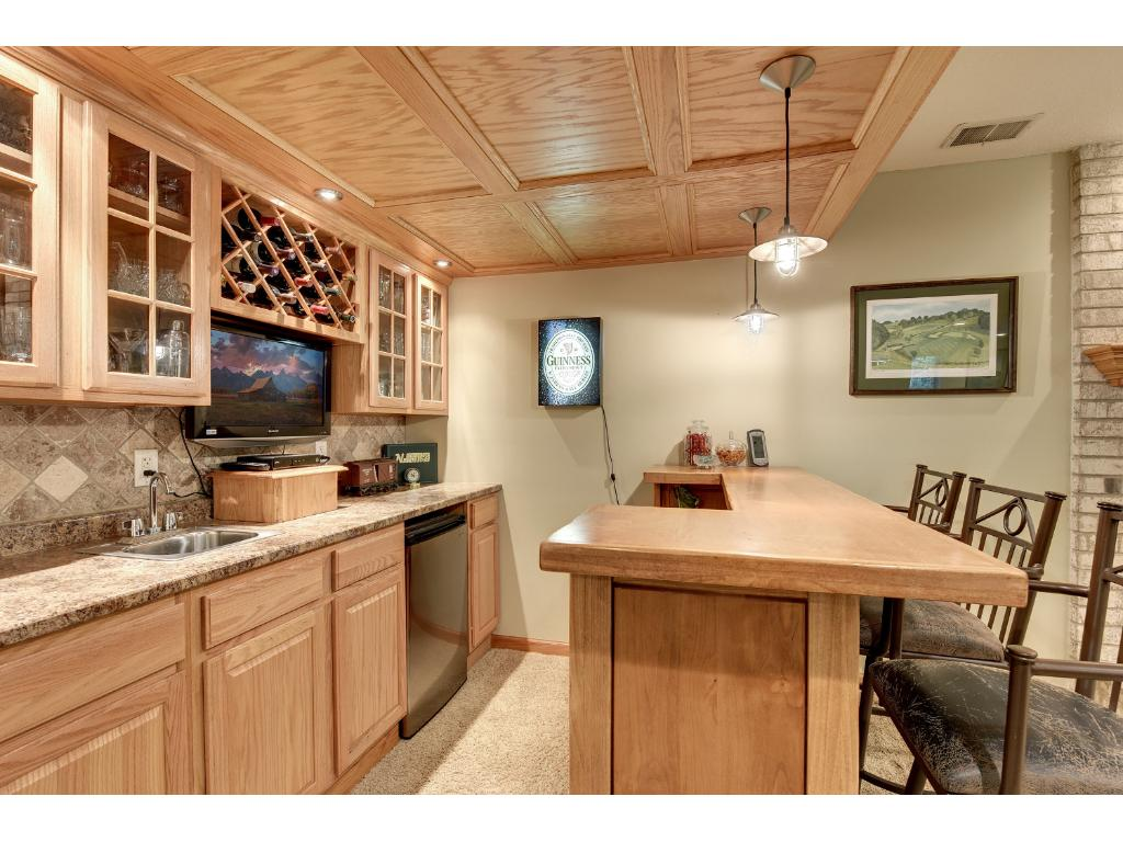 Lower Level Built in Wet Bar with Flat Screen TV and refrigerator.   Great for entertaining.