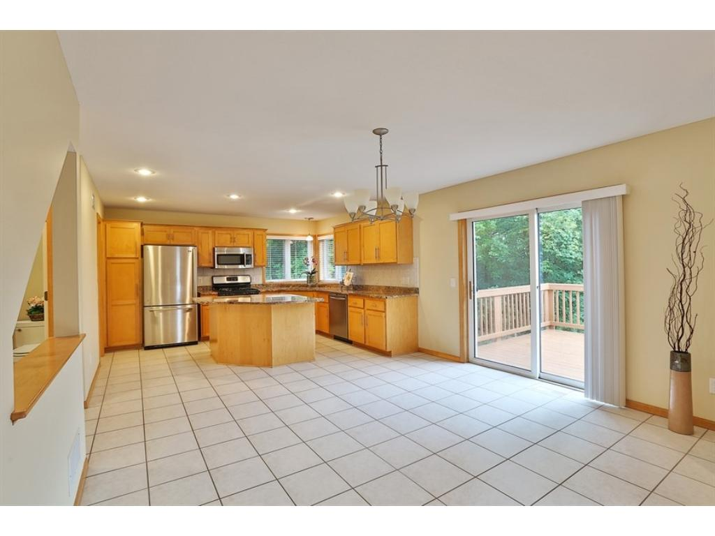 Look at this space!  Very spacious Dining area located between the fabulous Kitchen and the Great Room.   Patio doors lead to a backyard Deck and fenced backyard.