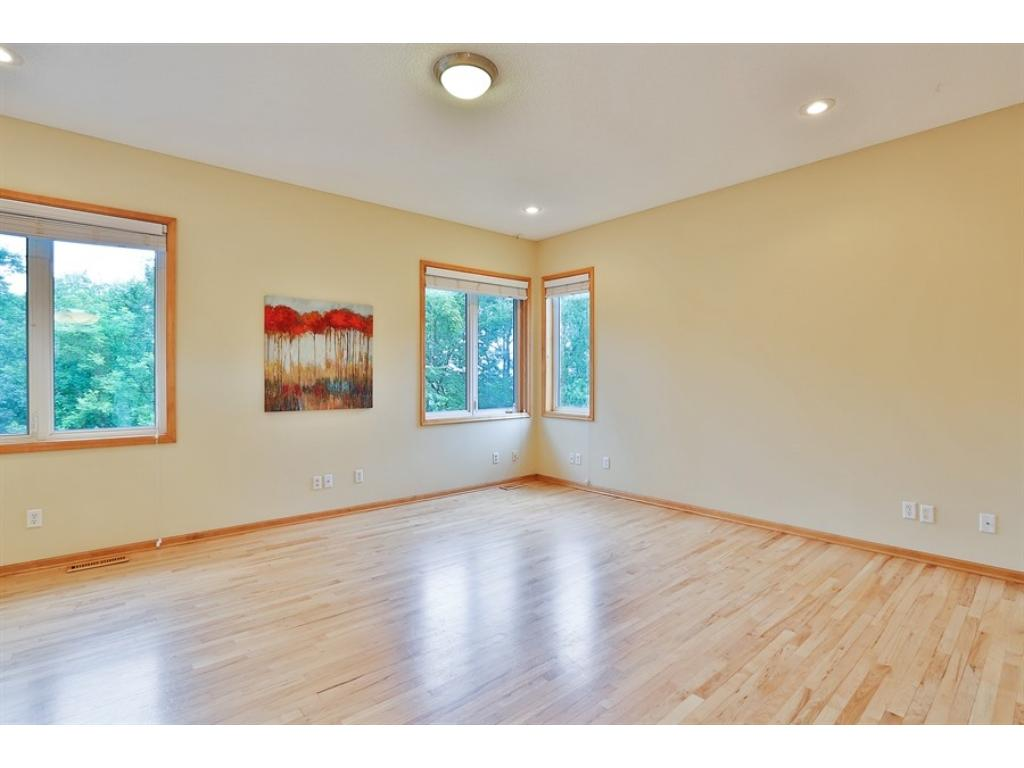 Big Great Room with real maple hardwood floors.  This home has extensive wiring in place and throughout for a sound system.
