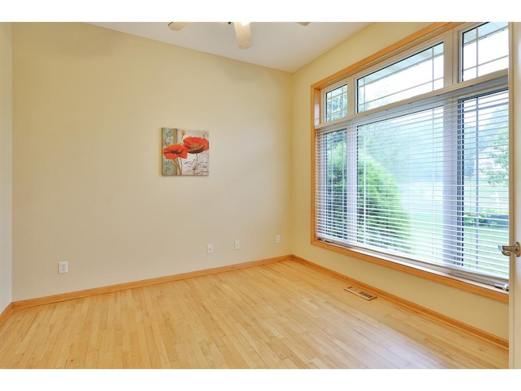 Main floor Home Office / Den located just off the Foyer with French Doors and hardwood floors.