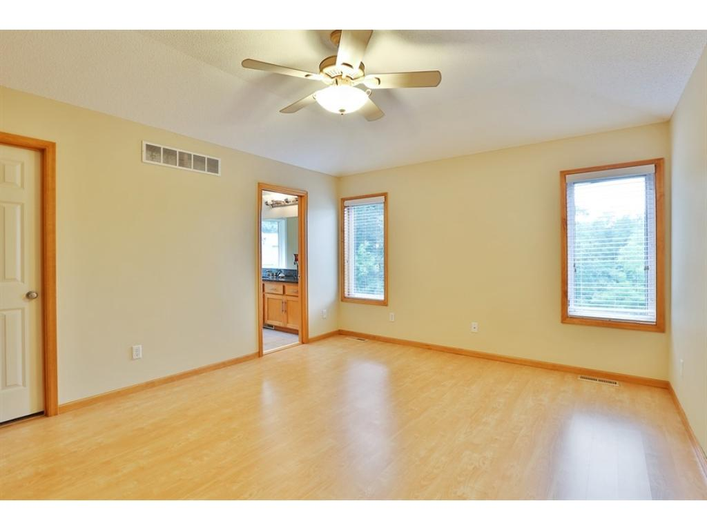 Spacious Master Suite with hardwood floors and adjacent Master Bath.