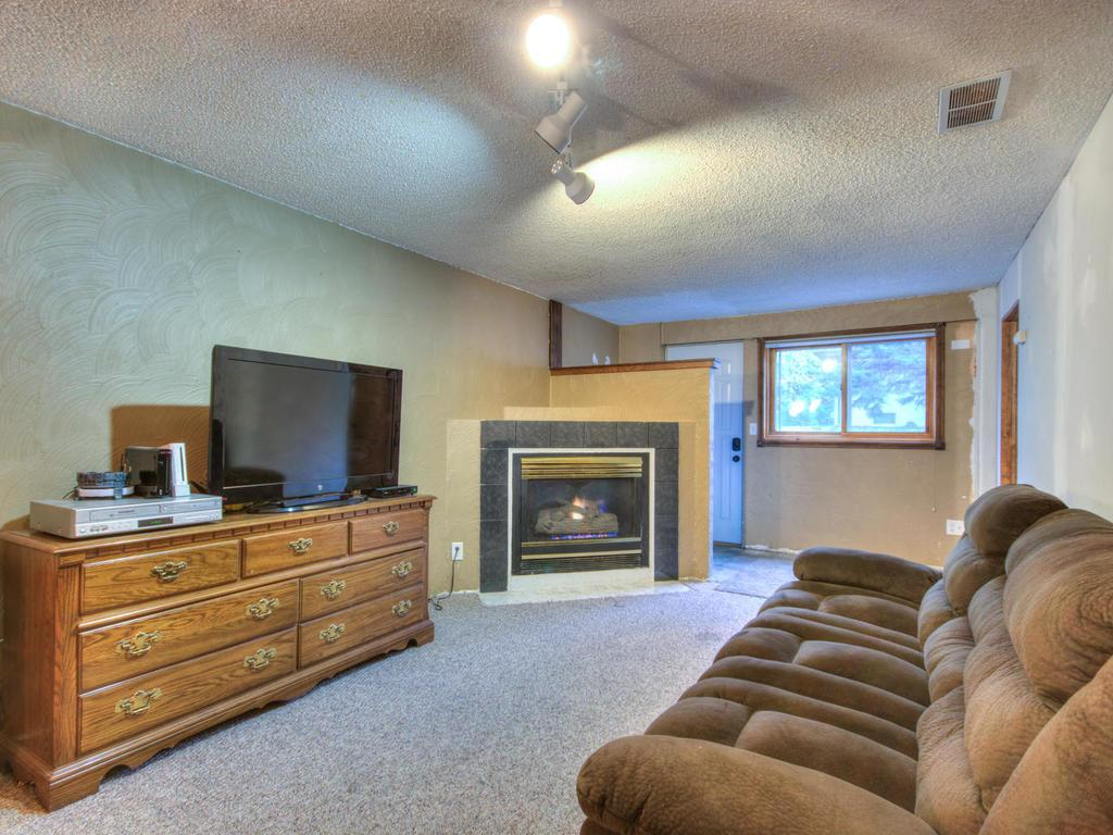 Family room with gas fireplace.