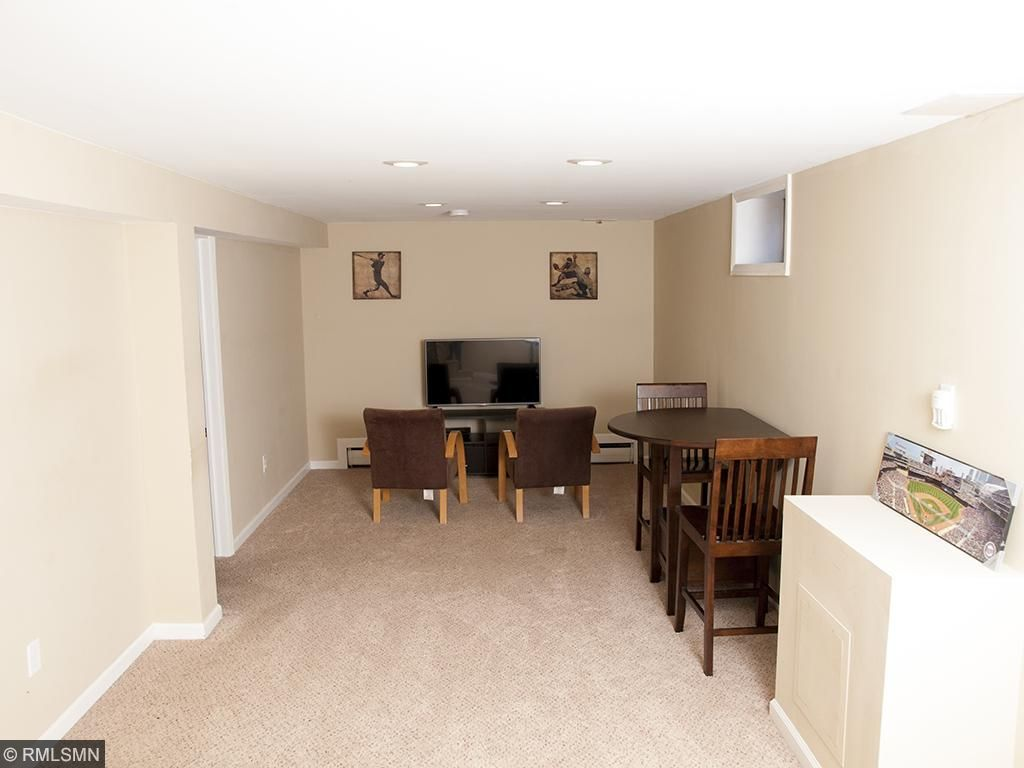 Finished lower level family room and adjacent 4th  bedroom