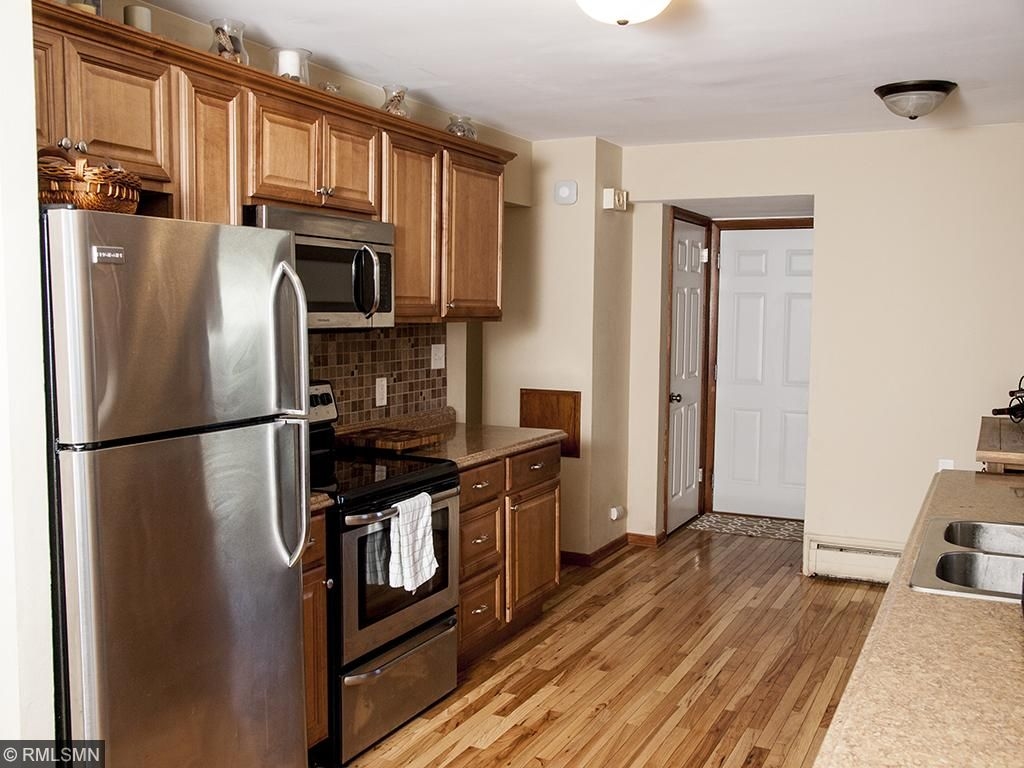 Beautifully updated kitchen with hardwood floors and stainless appliances