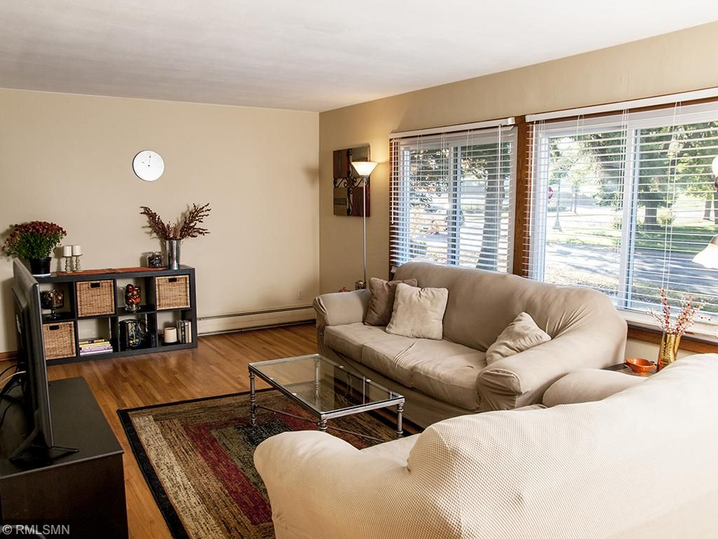 Bright south facing living room with hardwood floors