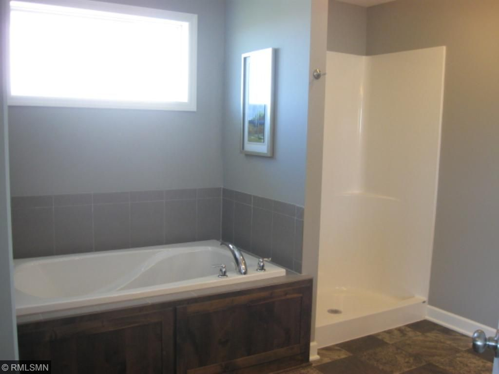 relax in the jetted tub. In a hurry?  There's a separate shower as well.
