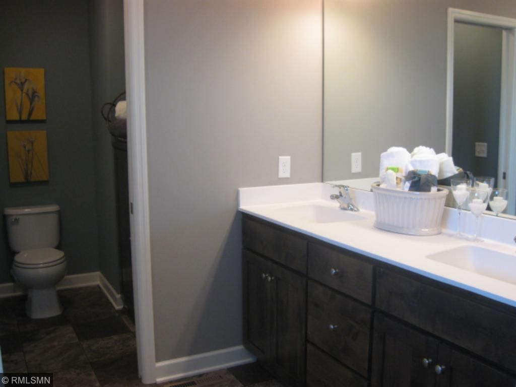 Lovely master bath has a separate water closet and dual vanities