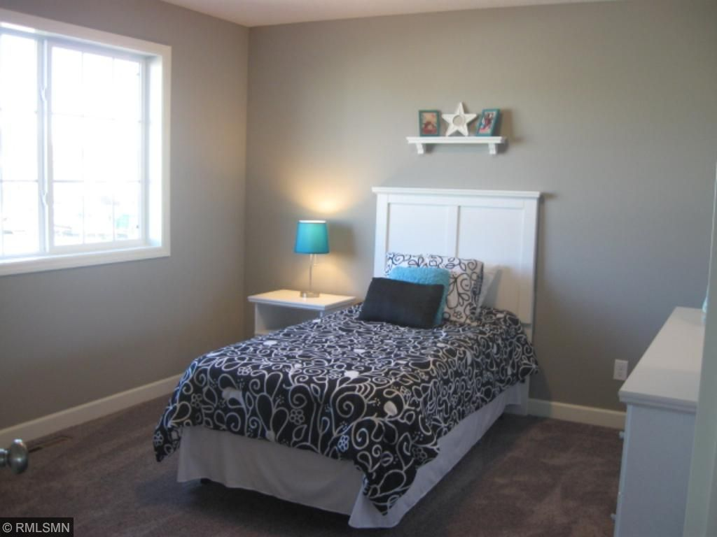 One of four bedrooms in the upper level.  Nice size closets too