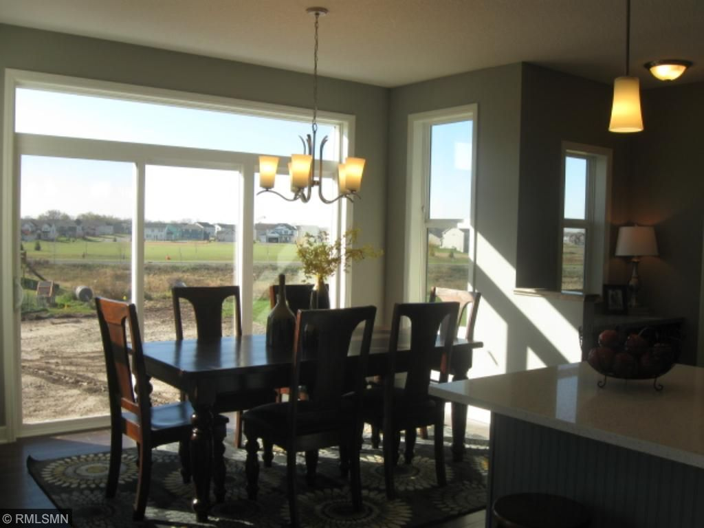 Spacious light filled informal dining area features a 9' patio door and transom windows.