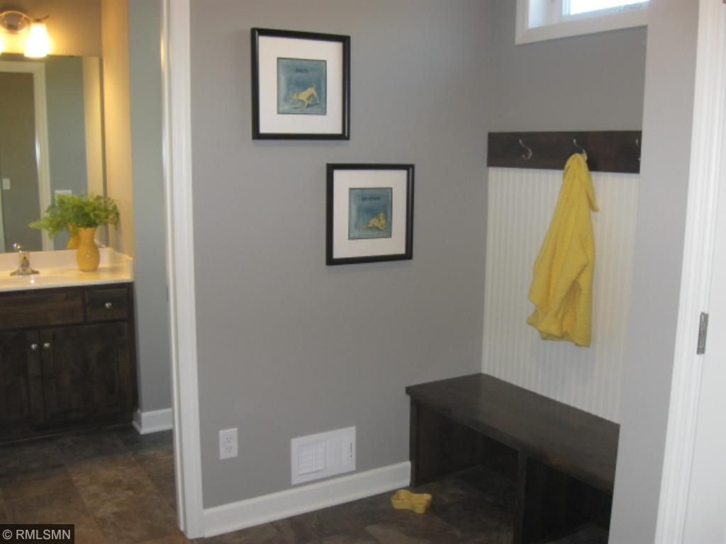 Walk in from the garage into the mudroom, easy to drop back packs, boots, shoes and jackets in the nice size closet.