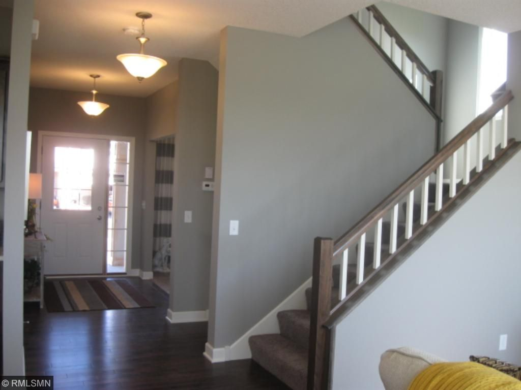 beautiful wood floors in the foyer, kitchen, and informal dining area
