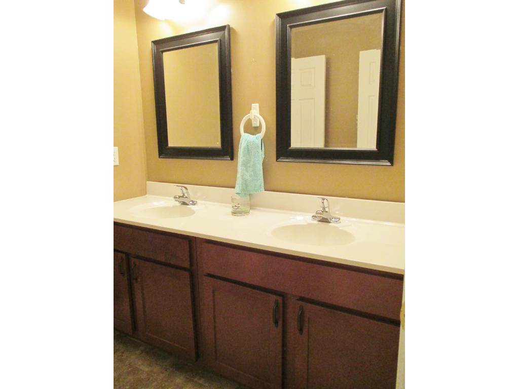 Upper Full Bath with double sinks.