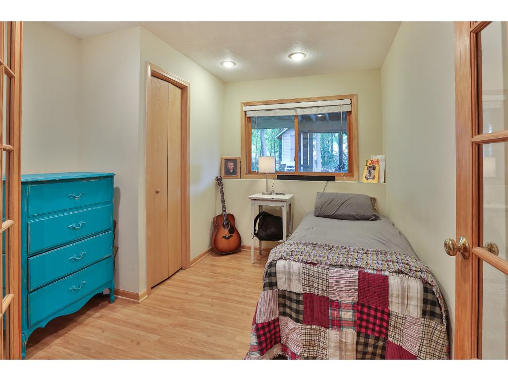 The lower level guest bedroom also makes a great office or den with french door at the entry.