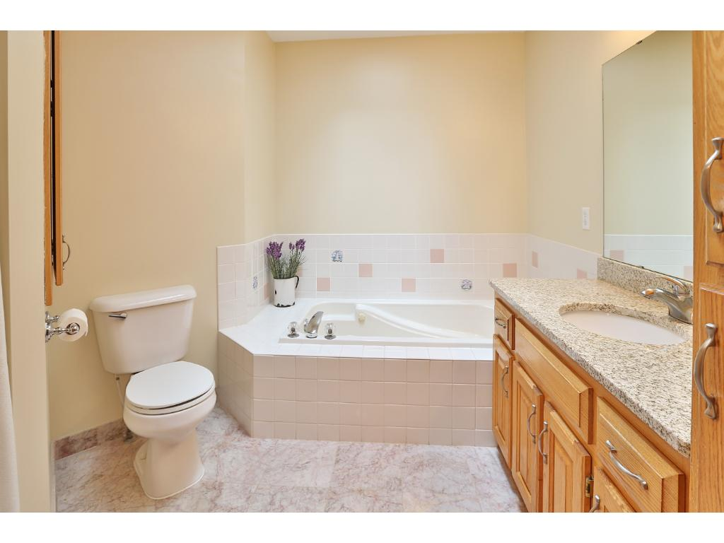 The bathroom features granite counter tops,  large jetted soaking tub, a separate shower and beautiful skylight to bring in the natural light.
