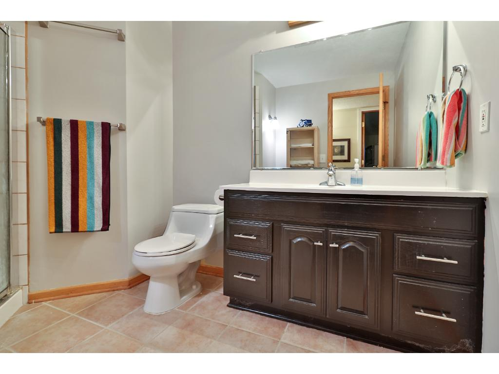 The second bathroom is 3/4 with updated vanity.