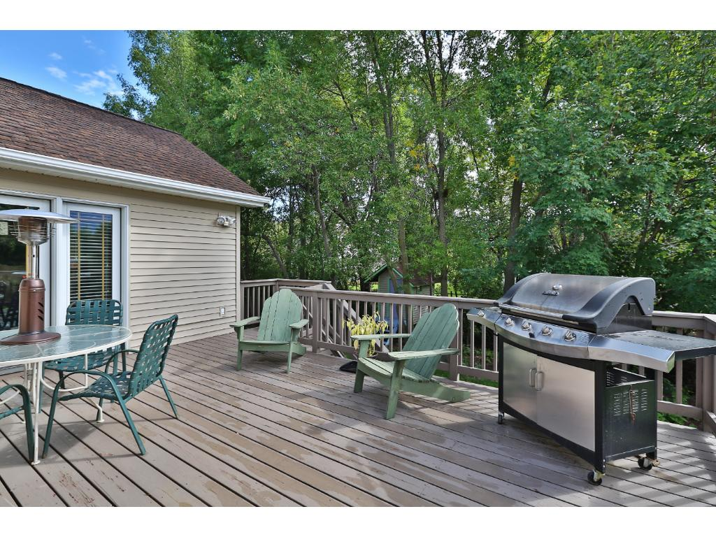 You will love the spacious deck with wooded views and stairs down to the back yard.