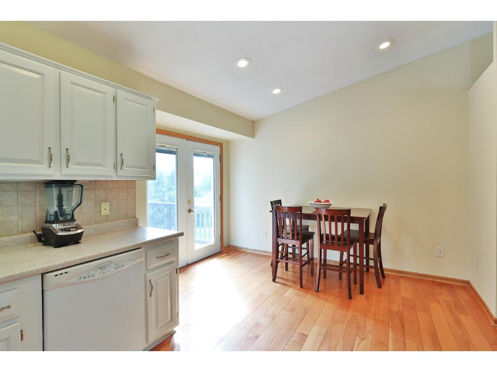 A view from the kitchen to the informal dining space which leads out to the rear deck.