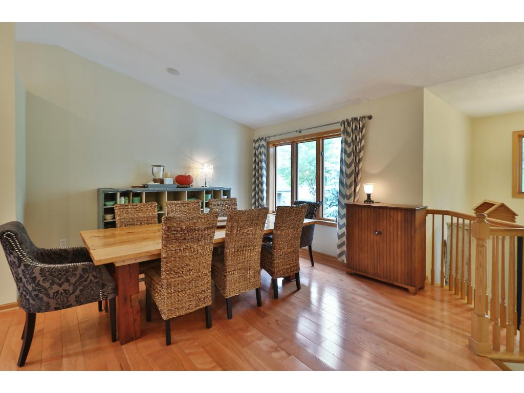 The formal dining space is adjacent to the kitchen and has great natural light.