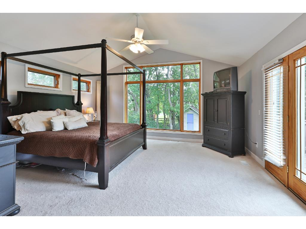 The main level features a huge master suite addition on the rear of the home with vaulted ceilings and a great walk-in closet.