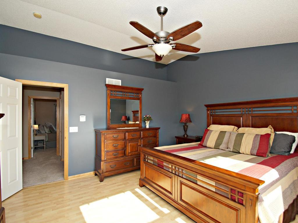 Captivating vaults and display niche add elegance to this charming and large 15x14 master bedroom.