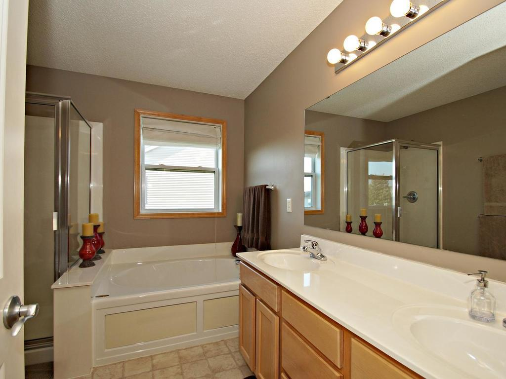 Peaceful retreat off the master bedroom with dual sinks, separate shower and soaking tub perfect for fall nights.