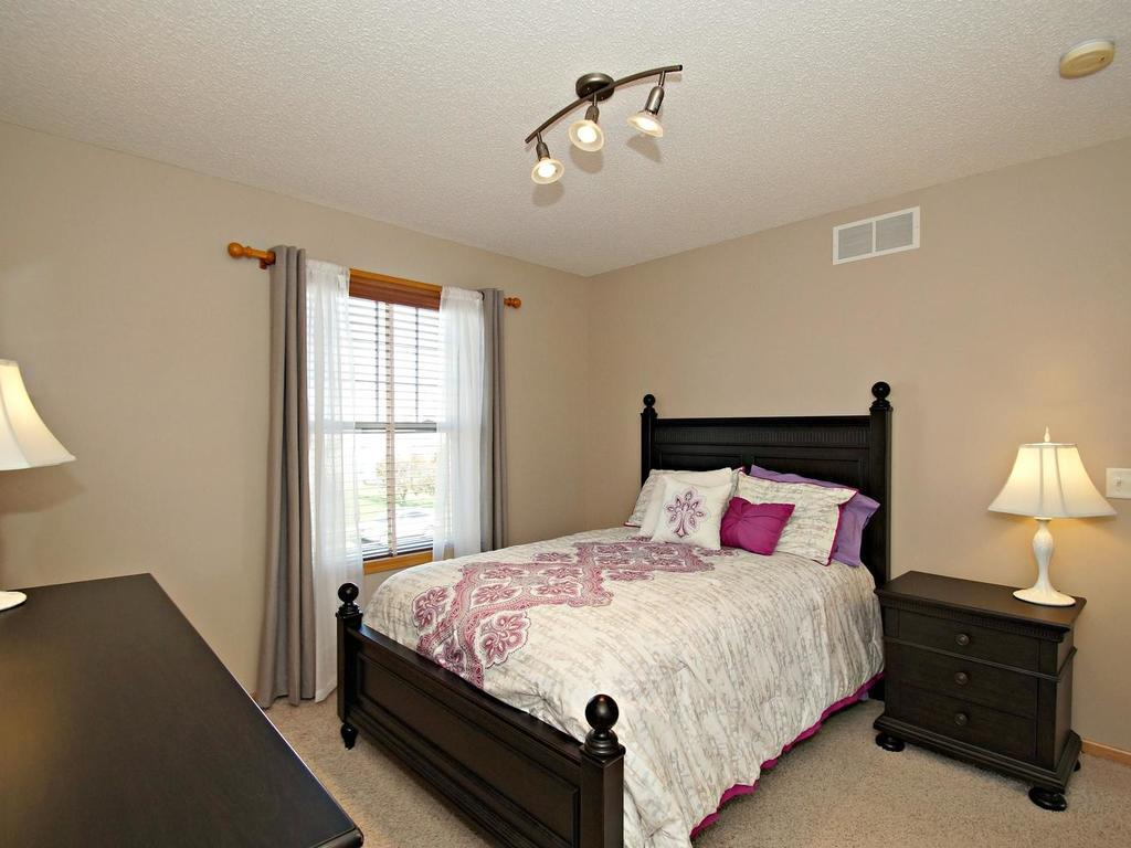 Large 2nd bedroom with full sized closet and organizer! Shown with queen bed!